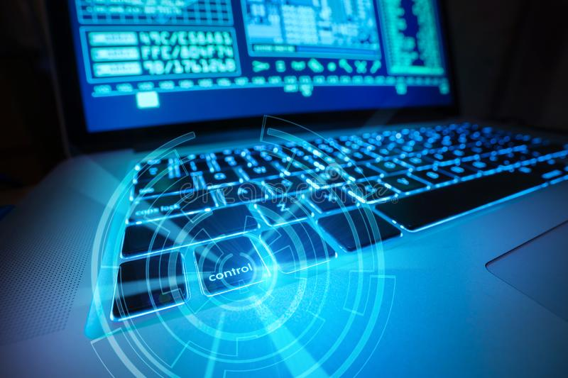 Futuristic scene of a laptop keyboard with digital media shown on the display. royalty free stock images