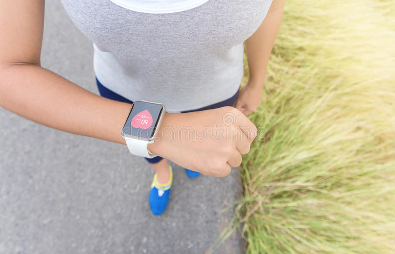 Digital hand watch on woman hand stock photo