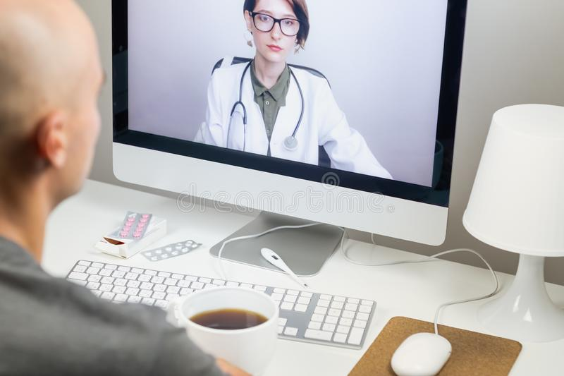 Digital health concept: a patient having online meeting with a p. Racticing physician from home. Medical doctor consulting a person by means of web conference stock images
