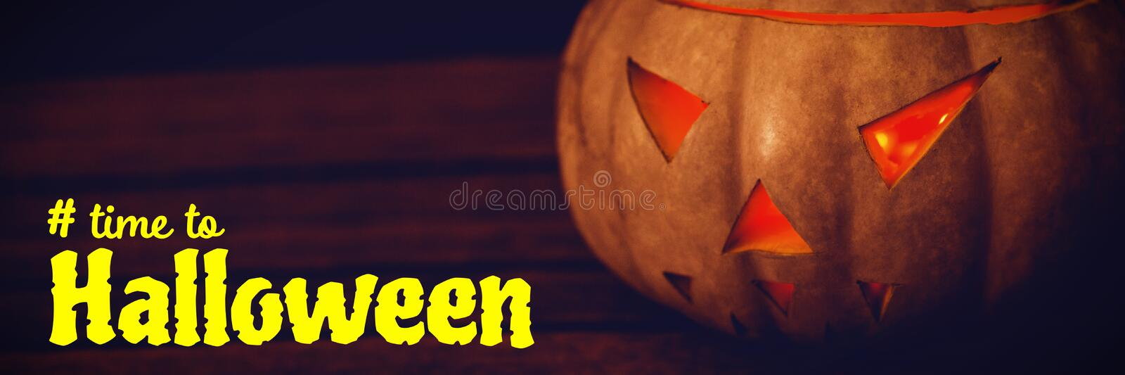 Composite image of digital image of time to halloween text. Digital image of time to Halloween text against close up of illuminated jack o lantern on table royalty free stock photo