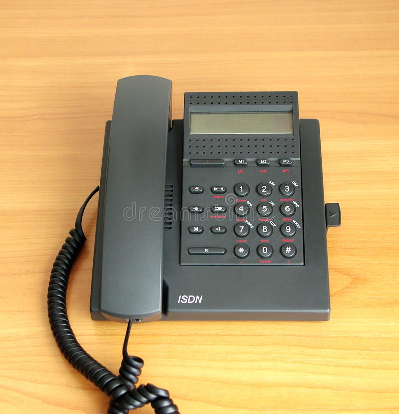 Digital(ISDN) telephone. On beige color background stock image