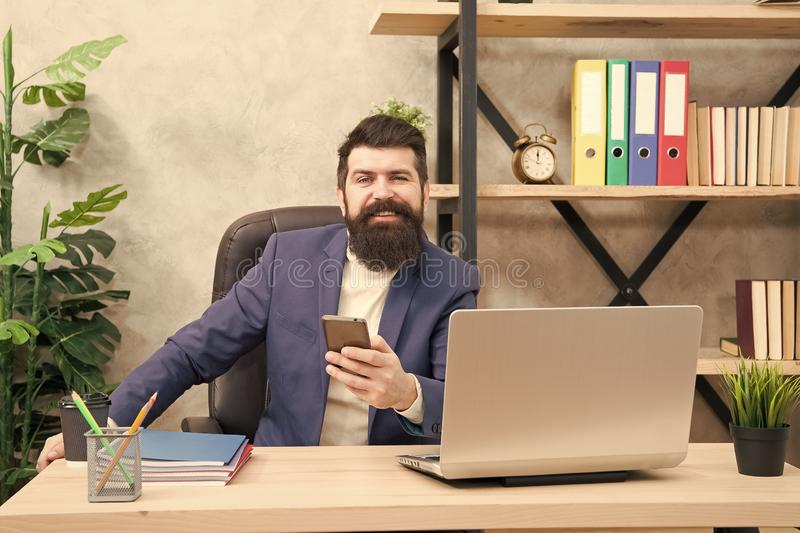 Digital marketing. Businessman in formal outfit. man use laptop and smartphone. Boss workplace. Bearded man in business royalty free stock photo