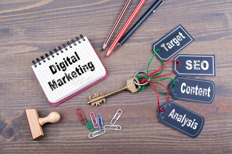 Digital Marketing concept. The key to success on a wooden office desk stock photo