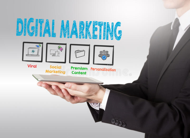 Digital Marketing concept, young man holding a tablet computer royalty free stock images