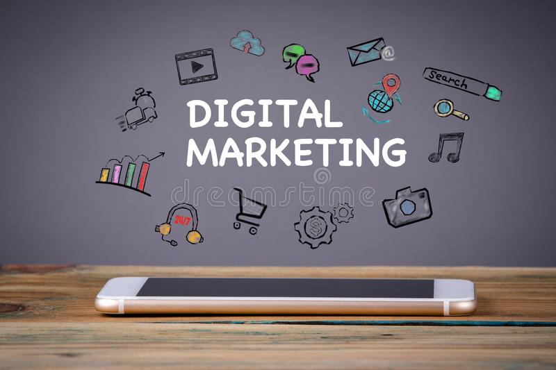 Digital Marketing, Media Technology concept. Mobile phone on a wooden table and a gray background royalty free stock photo