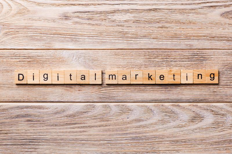 Digital Marketing word written on wood block. Digital Marketing text on wooden table for your desing, concept stock images