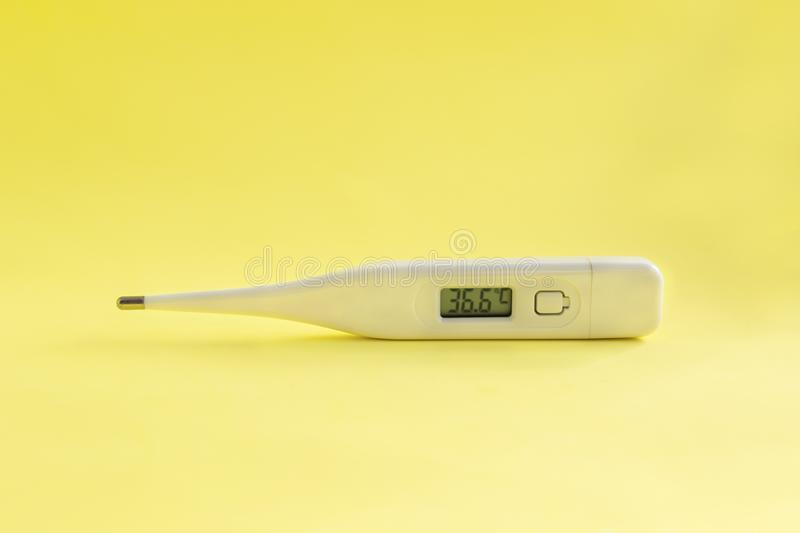 Digital medical thermometer with temperature of 36.6 stock images