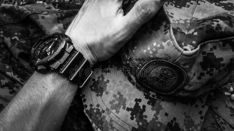 Digital military uniform with military watch stock photos