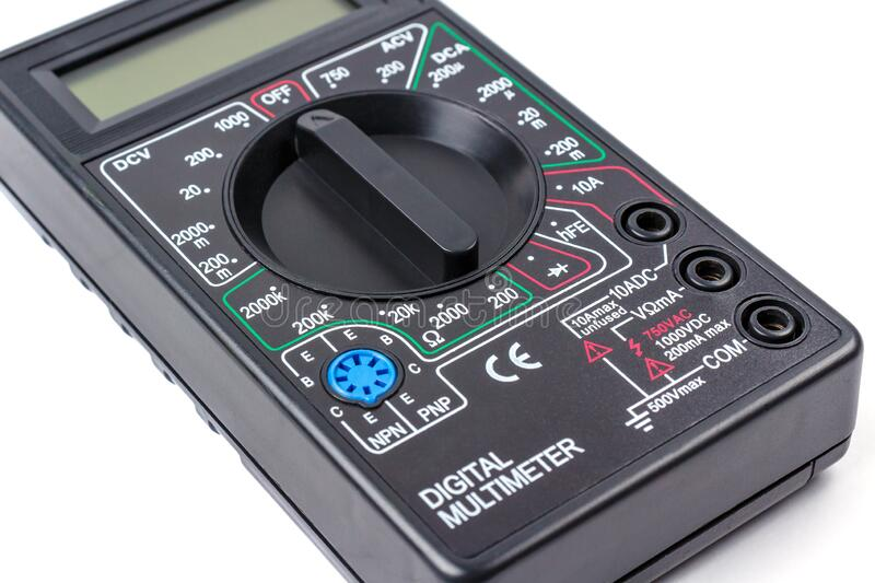 Digital multimeter in black plastic case close-up on a white background stock photo