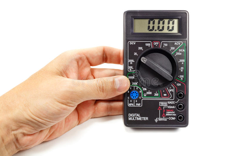 Digital multimeter in man`s hand on a white background royalty free stock photography