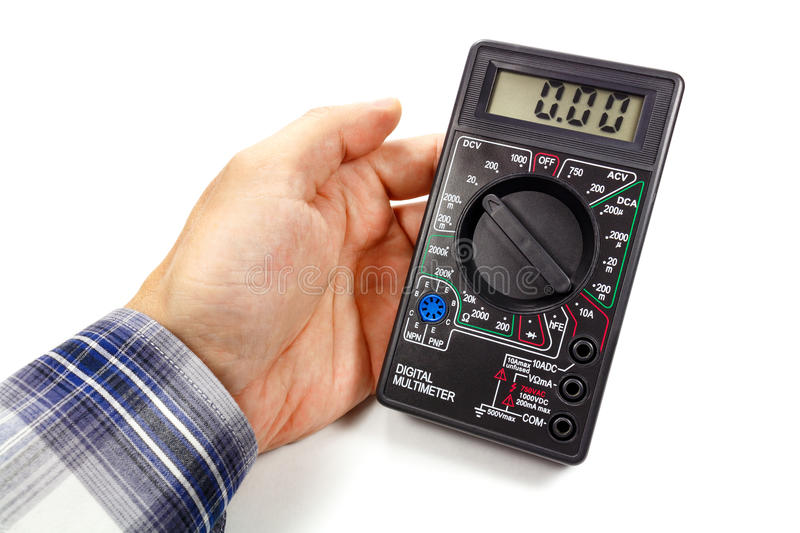 Digital multimeter in man`s hand on a white background stock photos
