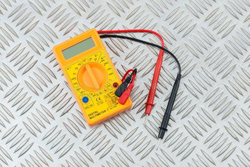 Digital Multimeter on a Steel Tread Plate. Digital multimeter tester on a steel tread plate stock photos