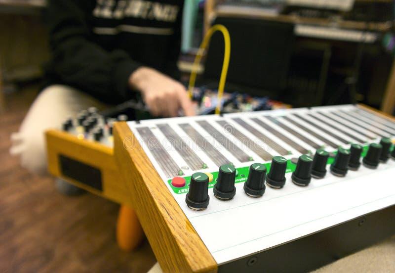 Musician playing on digital keyboard stock photo