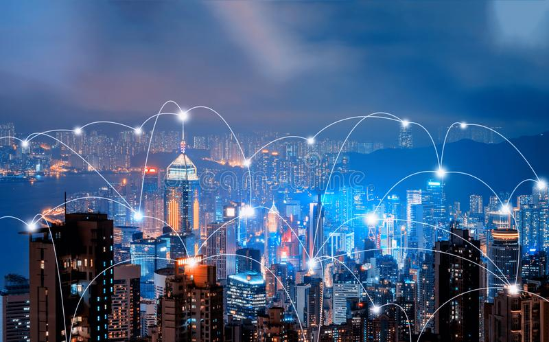 Digital network connection lines of Hong Kong Downtown and Victoria Harbour. Financial district in smart city in technology. Concept. Skyscraper and high-rise royalty free stock images