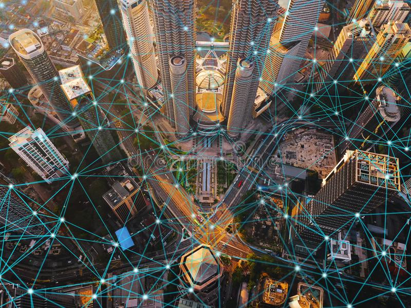 Digital network connection lines of Kuala Lumpur Downtown, Malaysia. Financial district and business centers in smart city in stock photography
