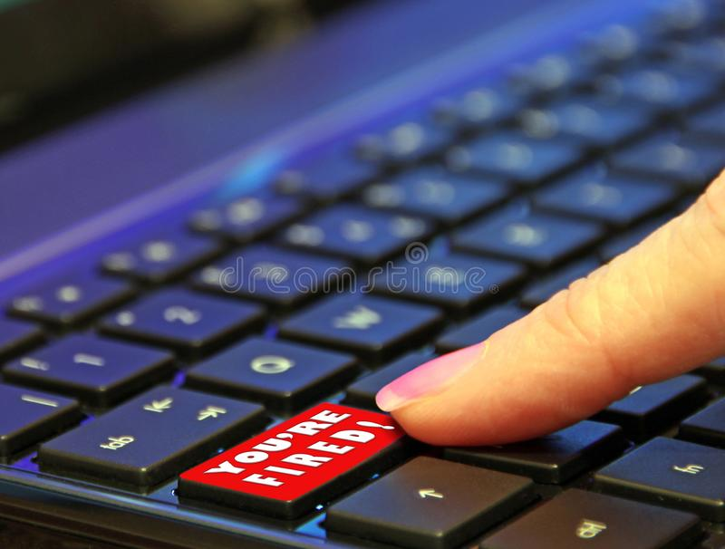 Digital online internet red you`re fired button finger push pressing press pushing keyboard switch royalty free stock photo