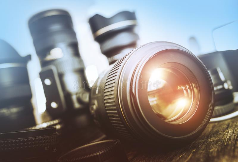 Digital Photography Set. Photography Equipment. Professional Lenses on a Table royalty free stock photo