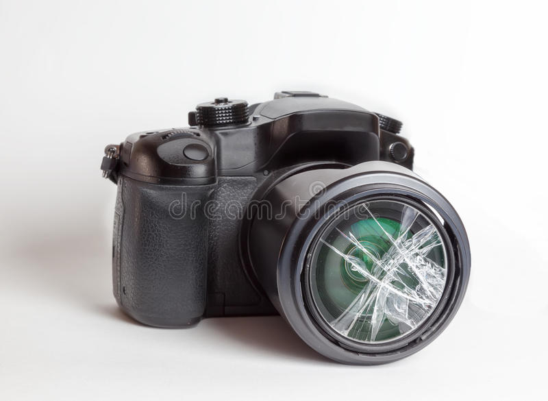 Digital reflex camera with the front lens broken. stock photo