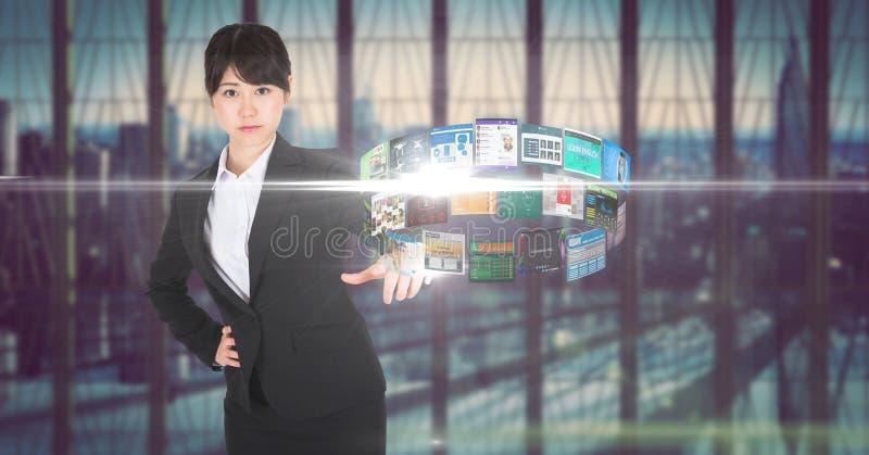 Digital sammansatt bild av affärskvinnaanseendet på det futuristiska skrivbordet arkivfoto