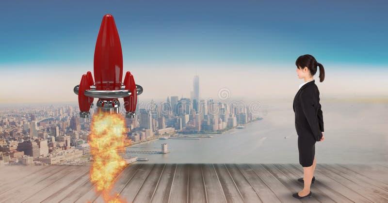 Digital sammansatt bild av affärskvinnaanseendet på pir och den hållande ögonen på raket att lansera mot stad royaltyfri bild