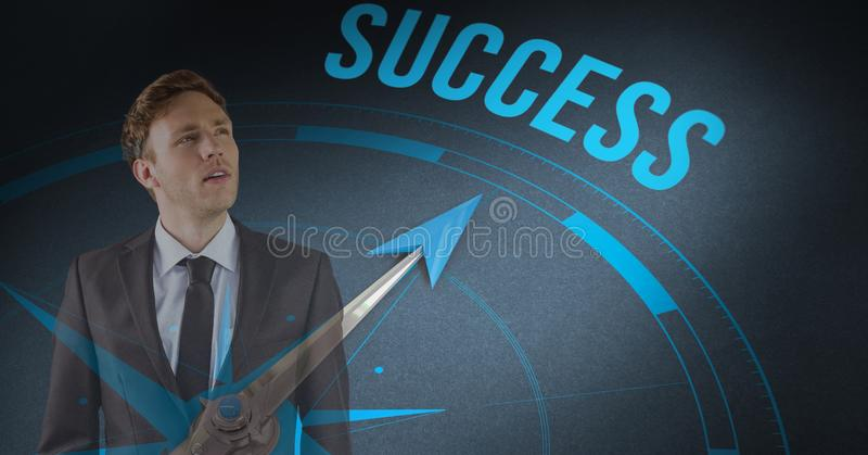 Digital sammansatt bild av affärsmananseendet vid framgångtext med kompasset royaltyfri fotografi