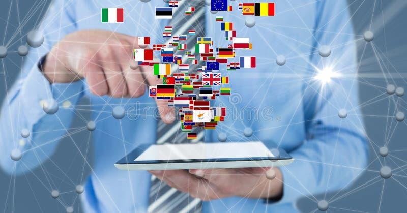 Digital sammansatt bild av affärsmannen som rymmer den digitala minnestavlan med flaggor och förbinder prickar royaltyfri fotografi