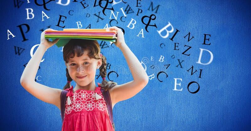 Digital sammansatt bild av bärande böcker för flicka på huvudet med bokstäver som flyger i bakgrund royaltyfria bilder