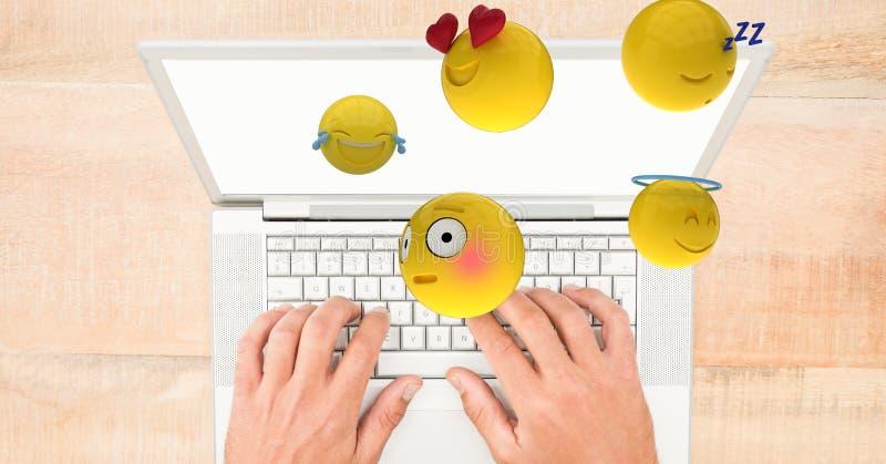 Digital sammansatt bild av emojis som flyger över händer genom att använda bärbara datorn på tabellen stock illustrationer