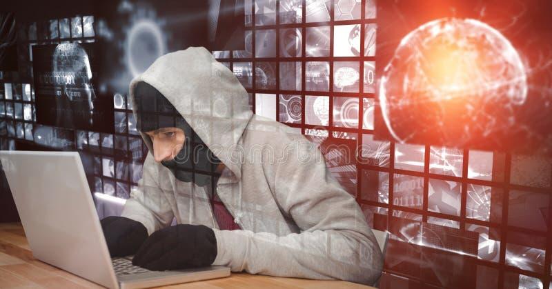 Digital sammansatt bild av en hacker som använder bärbara datorn på skrivbordet fotografering för bildbyråer
