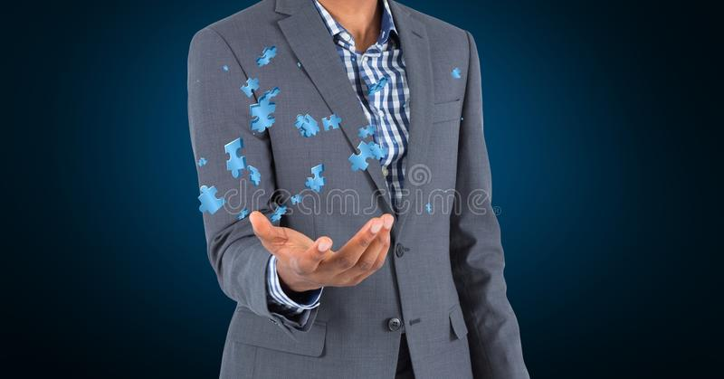 Digital sammansatt bild av hållande pusselstycken för affärsman fotografering för bildbyråer