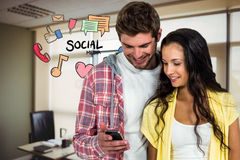 Digital sammansatt bild av par genom att använda den smarta telefonen med hemmastadda olika symboler fotografering för bildbyråer