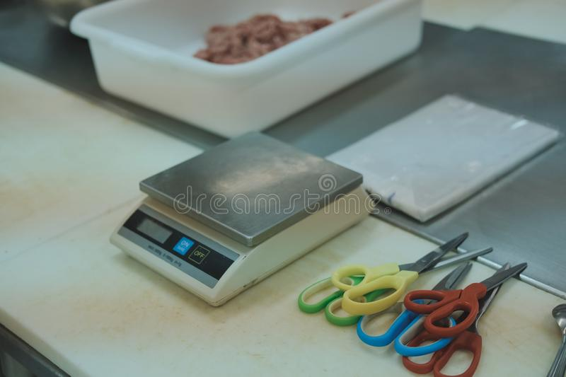 Digital scale scissors in food production factory industry. Digital electronic scale scissors in food production factory industry royalty free stock images