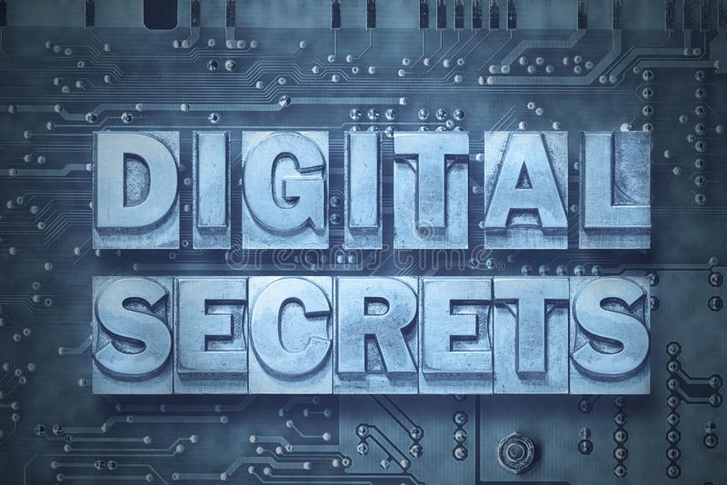 Digital secrets-pc. Digital secrets phrase made from metallic letterpress blocks on the pc board background stock illustration