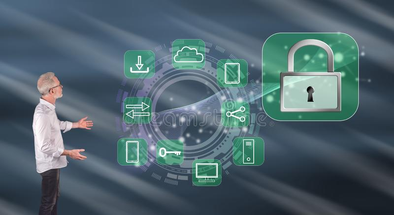 A digital security concept explained by a businessman on a wall screen. Businessman showing a digital security concept on a wall screen royalty free stock image
