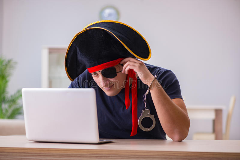 The digital security concept with pirate at computer royalty free stock photos