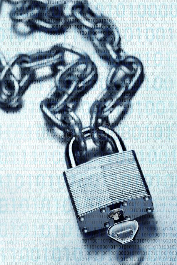 Digital security and encryption concept showing binary code overlaid on chain with steel padlock and key on scratched steel. Impenetrable digital security and royalty free stock photography