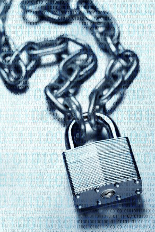 Binary code overlaid on chain and padlock; digital security and encryption. Digital security and encryption concept showing binary code overlaid on chain with royalty free stock image