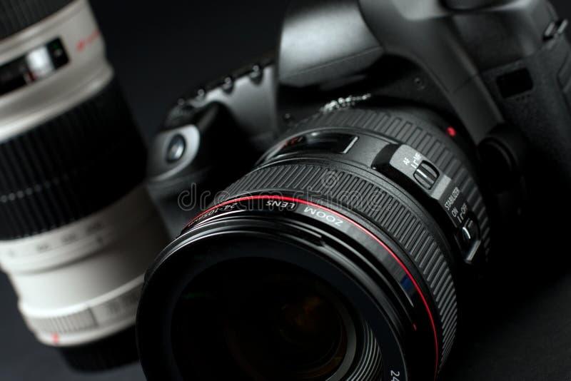 Digital SLR camera. Low key professional digital SLR camera stock photography