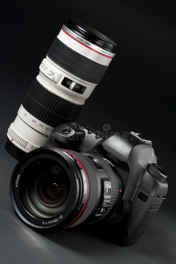 Digital SLR camera. Low key professional digital SLR camera royalty free stock photography