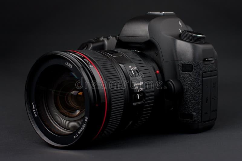 Digital SLR camera. Low key professional digital SLR camera stock images