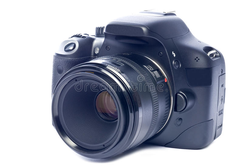 Digital SLR Camera. Front view of a black digital SLR camera isolated on white stock photography