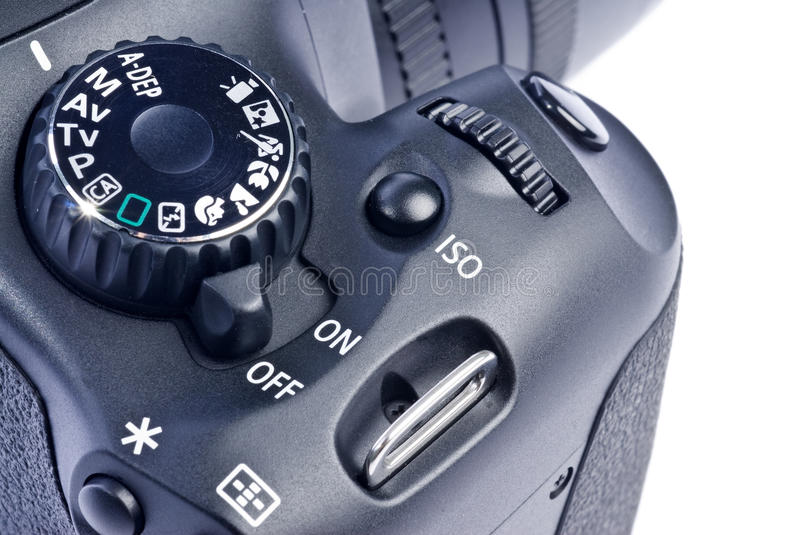 Digital SLR Camera. Close-up of a black digital SLR camera isolated on white royalty free stock photography