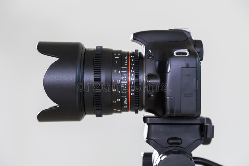 Digital SLR camera with interchangeable manual lens on a gray background. Shooting in the interior. The equipment for filmmaking royalty free stock photography