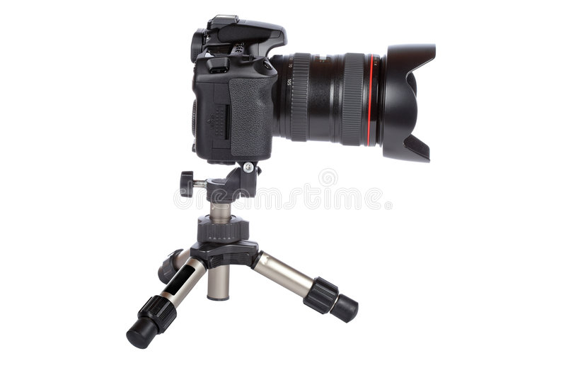 Digital slr camera and mini tripod royalty free stock images