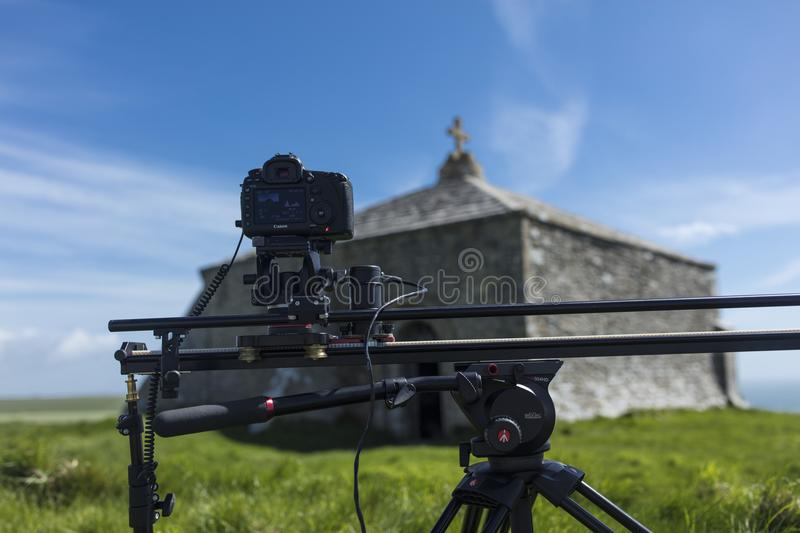 Digital SLR Canon Camera on a motion controlled track creating a royalty free stock image