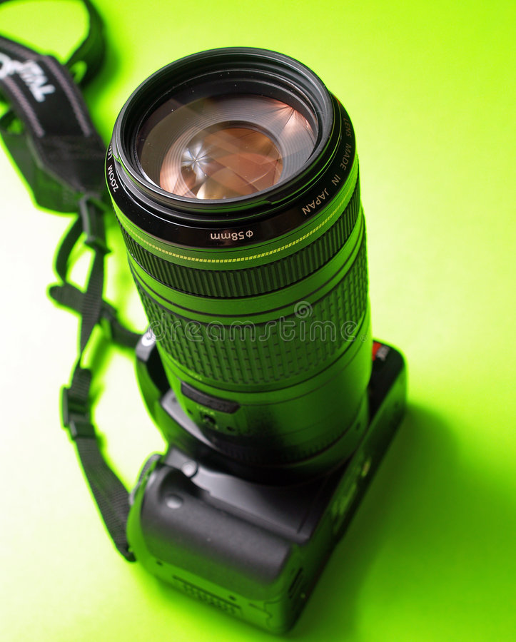 A digital SLR with a telephoto stock images