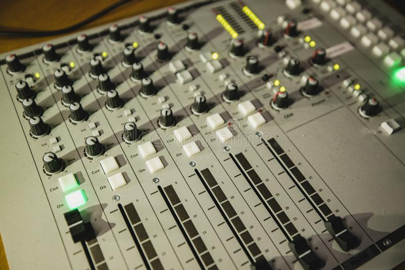 Digital Sound Mixing Equipment. A directly above shot of a sound mixer on a desk in a radio station studio royalty free stock image