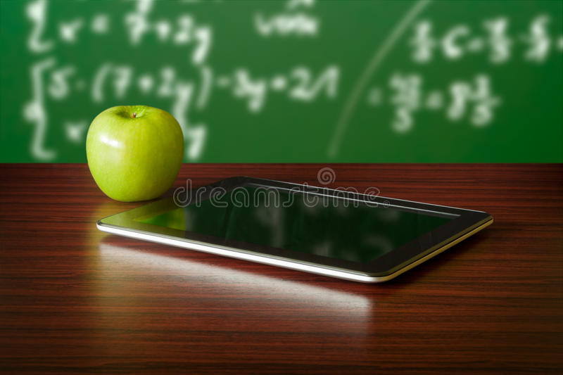 Digital tablet and apple royalty free stock photography