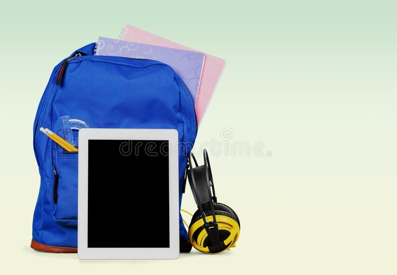 Digital tablet and backpack royalty free stock images