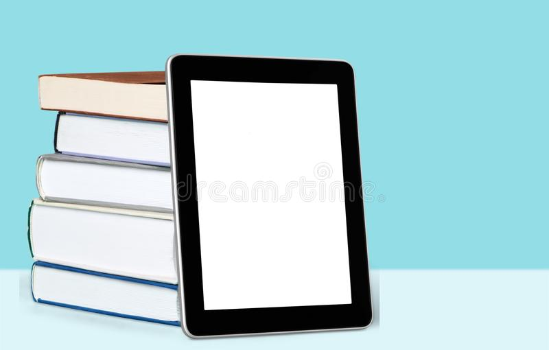 Digital tablet and book royalty free stock image